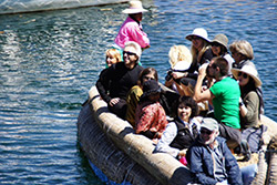 Gregg and the group having fun on a reed boat ride on magical Lake Titicaca