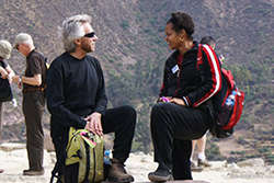 Gregg and a group member engaged in a lively conversation in the Sacred Valley